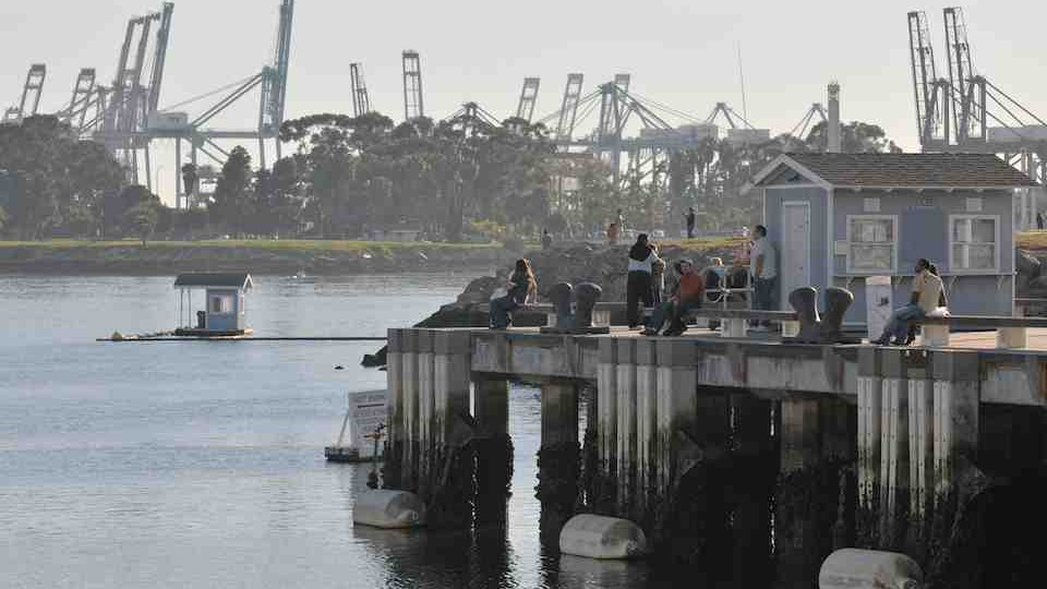 "CRANES FROM THE PORT OF LONG BEACH DOMINATE THE HORIZON OF ONE OF THE WORLD""S BUSIEST SEAPORTS"